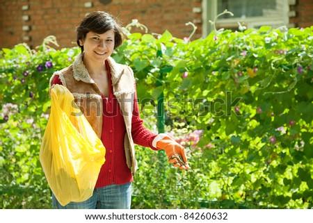 woman fertilizes the soil in garden