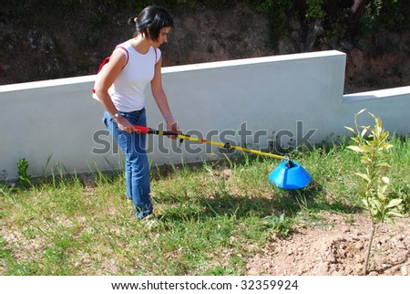 woman fertilizing the soil with sulphate