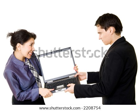 Woman fighting with man for a laptop