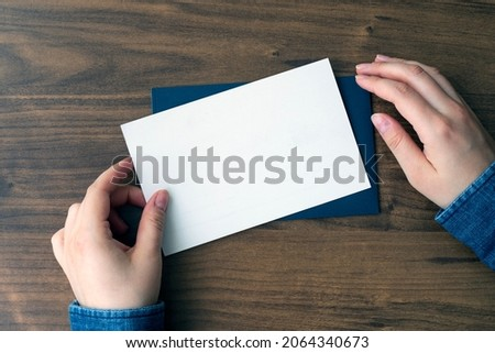Woman finger both hand holding white card