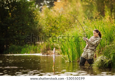 woman fishes on the river