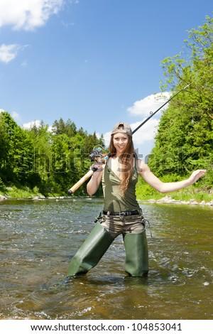 woman fishing in river, Czech Republic #104853041