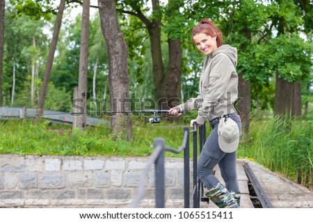 woman fishing in the river in spring #1065515411