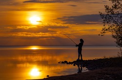 Woman fishing on Fishing rod spinning in Finland