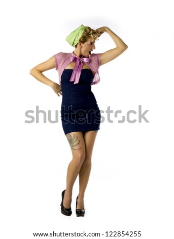 Woman flexing her biceps while standing over white background