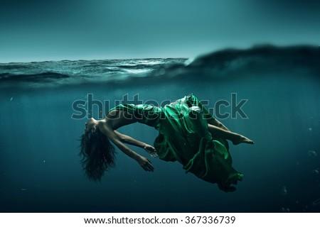 Stock Photo Woman floats underwater