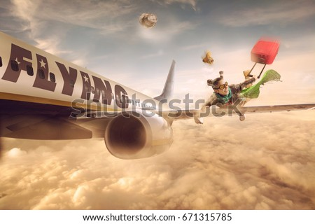 Woman flying in the wing of a moving plane, over clouds with luggage, low cost holiday concept. Photomanipulation