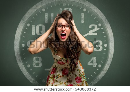 Woman freaking out in extreme anxiety panic attack, late, out of time, clock