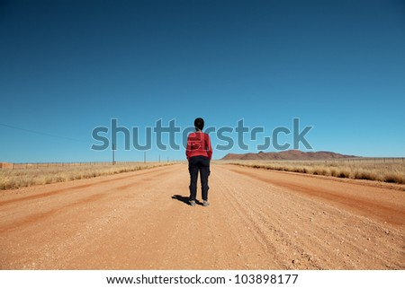 woman front back in the desert road namibia - stock photo