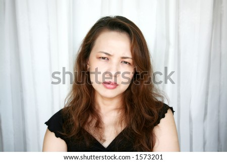 woman frowning looks troubled