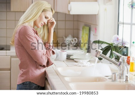 Woman Frustrated At Kitchen Counter