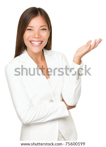 woman gesturing / showing. Businesswoman in white suit smiling looking at camera explaining with gesture. Beautiful young mixed race woman professional isolated on white background.