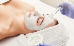 Woman gets beauty facial injections. Anti-aging, nourishing, vitamins treatment at spa salon. Aesthetic cosmetology
