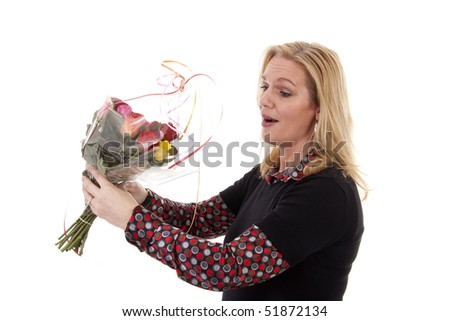 Woman gets flowers for mothers day or birthday over white background