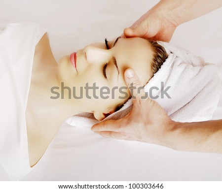 Woman getting a face massage