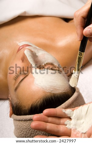 woman getting a facial at a day spa