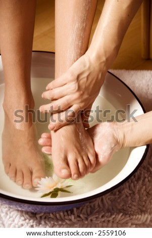 woman getting a foot massage with some cream - stock photo