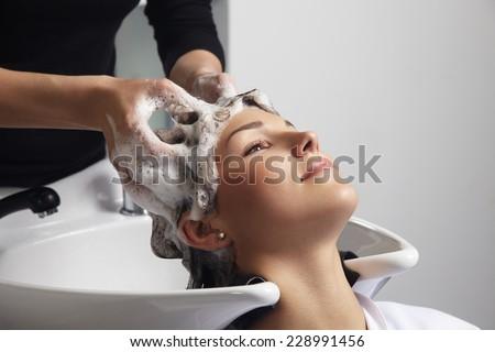 Shutterstock woman getting a hair wash procedure in salon