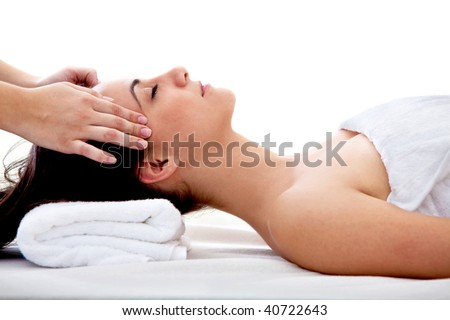 Woman  getting a massage on her face isolated on white