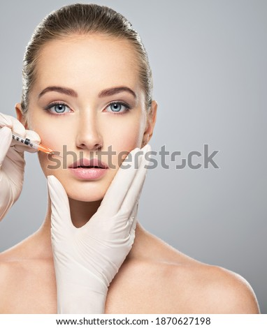 Woman getting cosmetic injection of botox near lips, closeup. Woman in beauty salon. plastic surgery clinic.