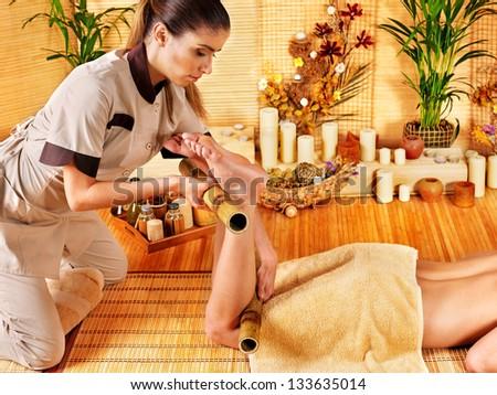 Woman getting feet massage. Male therapist.