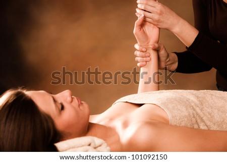 woman getting hand massage in spa salon