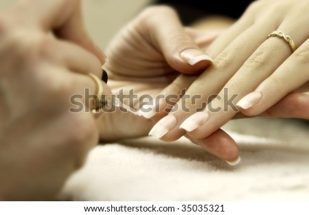 woman getting manicure