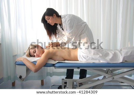 woman getting massage in a spa center