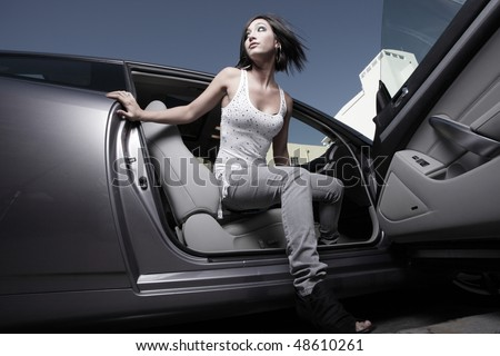 Woman getting out of a car