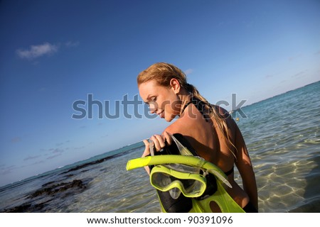 Woman getting out of water after snorkeling journey
