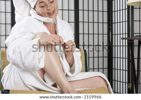 Woman getting ready to go out while talking on the phone