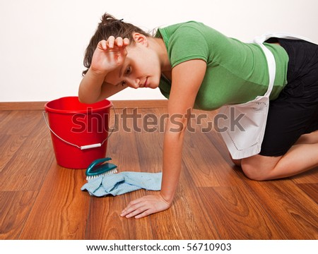 Woman getting tired after hard work of floor cleaning