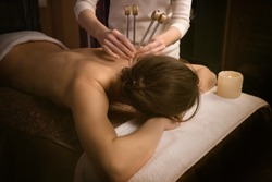 woman getting treatment. Acutonic relax massage and sound healing. Tuning forks