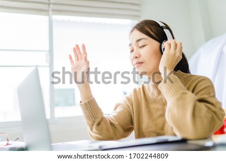 Woman girl stay at home wearing headphone pray and worship GOD with laptop.Prayer girl worship and pray from home for coronavirus crisis.Home church, Church online, Praying hands, Worship at home