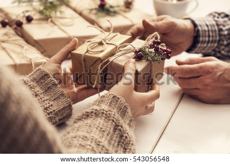 Woman gives gift in box