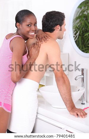 Woman giving a man a massage