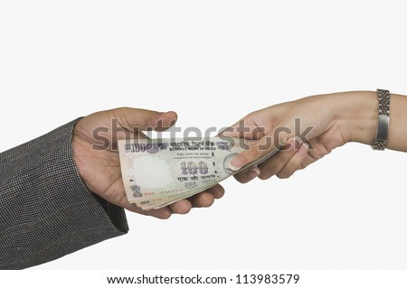 Woman giving money to a man