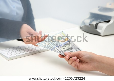 Woman giving money to teller at cash department window, closeup Stock foto ©