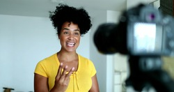 Woman giving testimony in front of camera doing explainer video