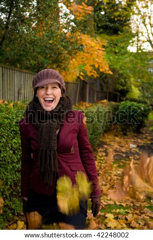 Woman goes for an autumn stroll in a park