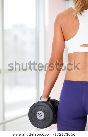 woman goes in for sports in sport hall