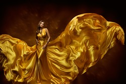 Woman Gold Dress, Lady In Fluttering Silk Gown, Fashion Beauty Model, Fabric Waving On Wind, Beautiful Girl With Long Dynamic Flying Cloth