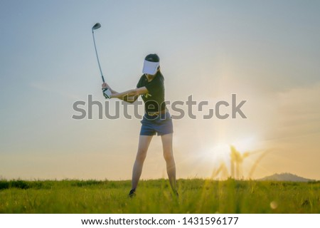 Woman golf player try to hit golf ball at the edge of the fairway back to green off, trouble in hit the ball into fairway, ball out of fairway, try to resolve hit slice or draw of the golfer