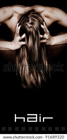 Woman Grabbing Her Beautiful Long Hair with text space below