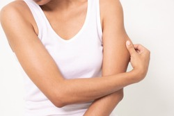 woman grabbing skin on her upper arm with the drawing arrows, Lose weight and liposuction cellulite removal concept, Isolated on white background.