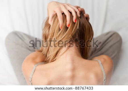 Woman Grabs Her Head