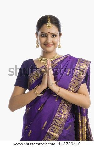 Woman greeting in mekhla - stock photo