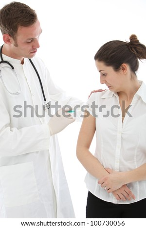 Woman grimacing as she receives an intramuscular injection in her upper arm from a doctor, nurse, or student intern