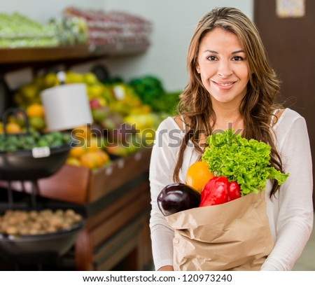 Woman grocery shopping at the local market
