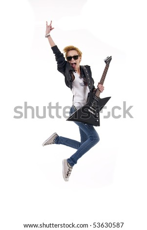 woman guitarist jumps making rock sign over white